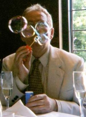 Charles J. Fillmore blowing bubbles