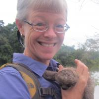 Christine Beier with baby sloth in 2016