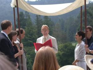 Chuck Fillmore officiating at Tess Wood wedding
